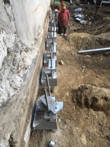 Underpinning foundation with helical piles - The Glebe